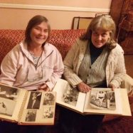 Gaby Noble and Lyn Dugmore exploring the circus albums.